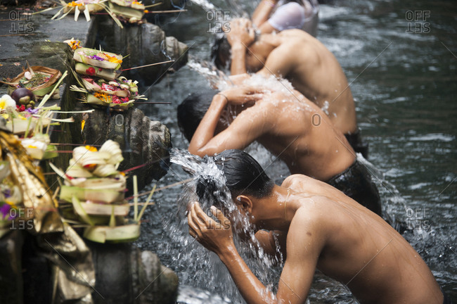 High angle view of men washing in fountains