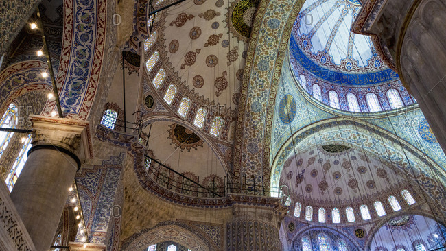 Istanbul, Turkey - January 1, 2014: Low angle view of Blue Mosque domes and mosaic