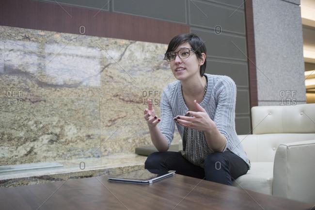 Caucasian businesswoman talking in office lobby