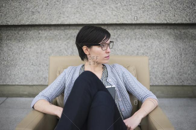 Caucasian businesswoman sitting in armchair