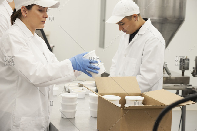Workers packing product in factory