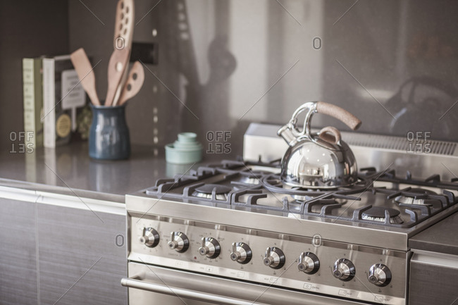 Kettle on stainless steel stove in modern kitchen