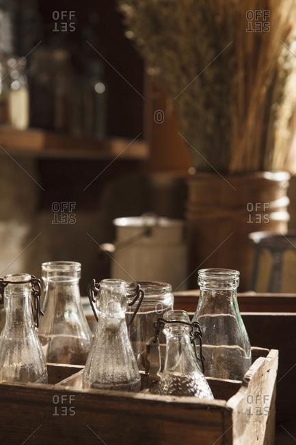 Vintage glass bottles in wooden crates