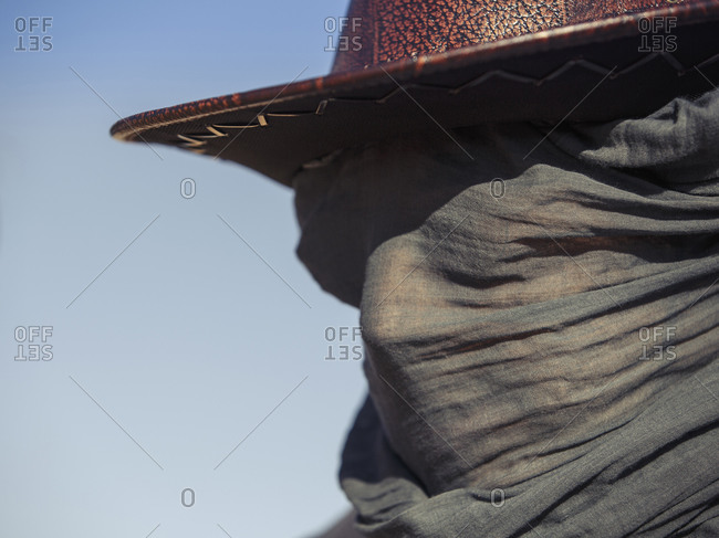 Close up of Caucasian traveler wearing face scarf