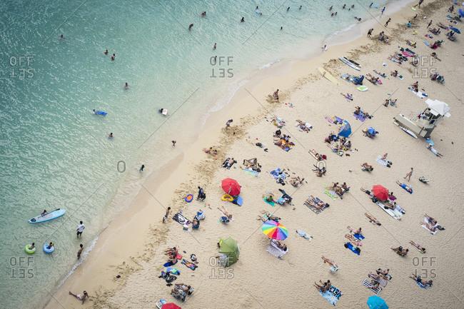 Honolulu, Hawaii, USA - August 12, 2012: Aerial view of tourists on beach