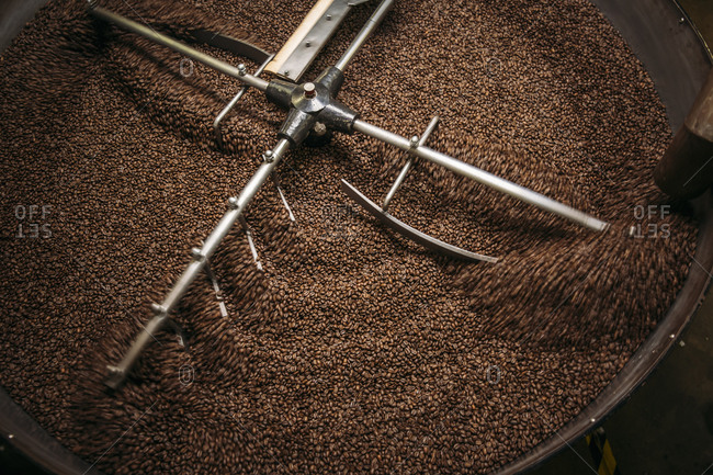 High angle view of equipment and beans in coffee roaster
