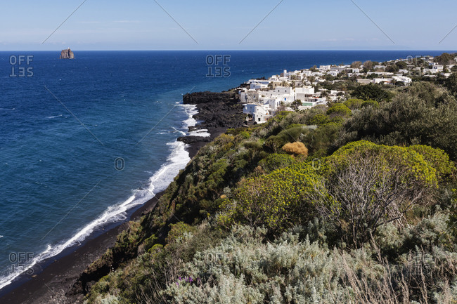 High angle view of cliff and ocean on Stromboli coastline, Messina, Sicily