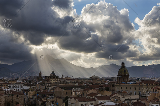 Aerial view of Palermo cityscape under sunbeams and clouds, Palermo, Italy