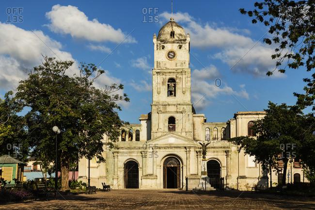 Church tower and plaza under blue sky, Holguin, Holguin, Cuba