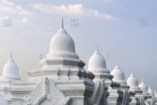Ornate domes under cloudy sky, Mandalay, Myanmar