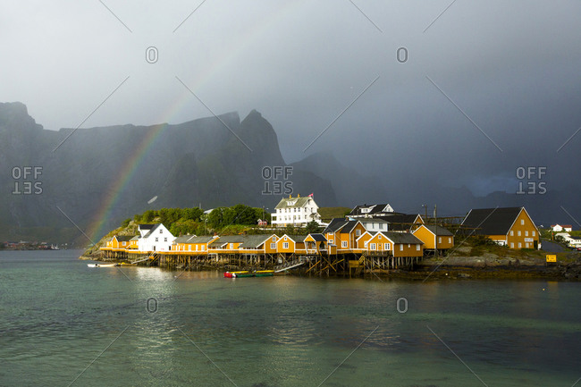 Rainbow over buildings in Sacrisoy, Lofoten Islands, Norway