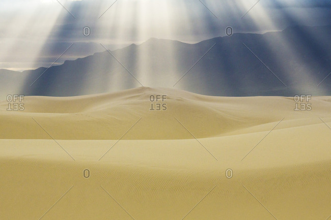 Sunbeams over sand dunes, White Sands National Monument, New Mexico, United States