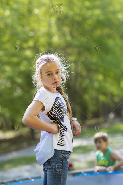 Caucasian girl standing on trampoline