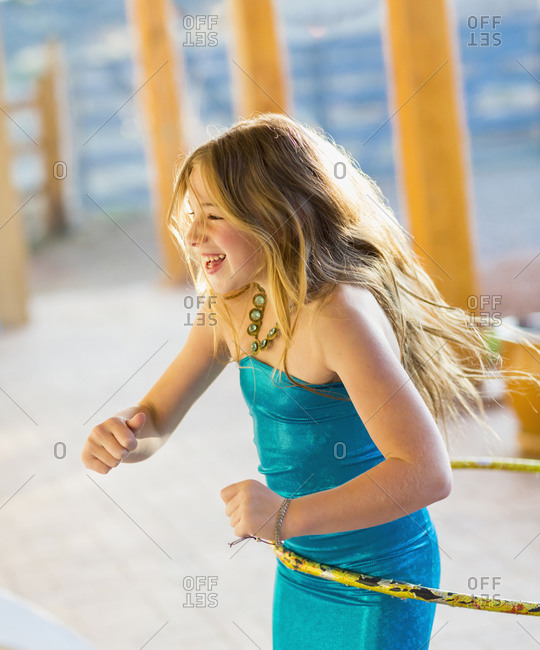 Caucasian girl playing with plastic hoop