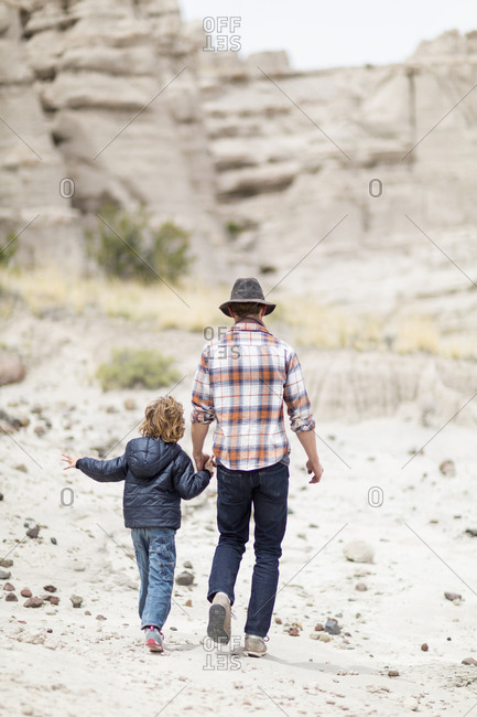 Father and son exploring desert rock formations