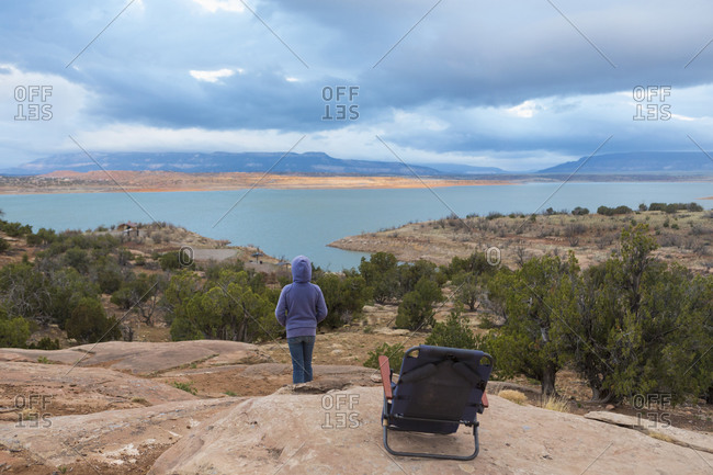 Caucasian  girl admiring scenic view from hilltop