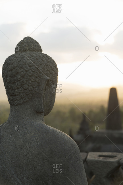 Buddha statue on Temple of Borobudur, Borobudur, Indonesia