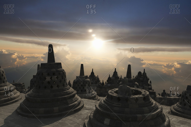 Spires on Temple of Borobudur at sunset, Borobudur, Indonesia