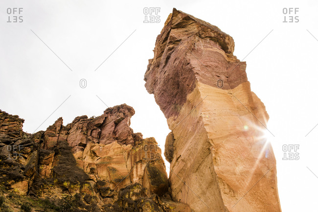 Low angle view of rock formation and cliff, Smith Rock State Park, Oregon, United States