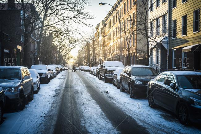 Tire tracks in snow on city street, New York, New York, United States