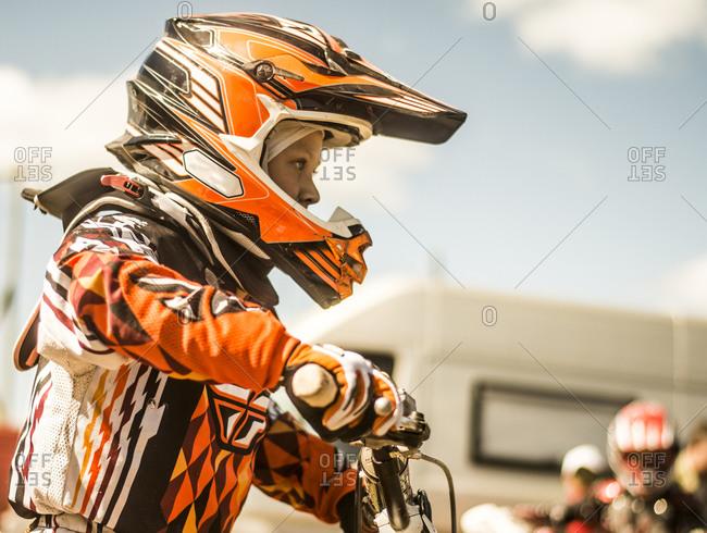 Caucasian motocross biker ready for race