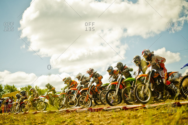 Ekaterinburg, Swerdlowsk, Russia - June 30, 2013: Caucasian motocross bikers ready for race