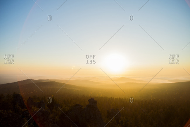 Sunrise over hills in remote landscape