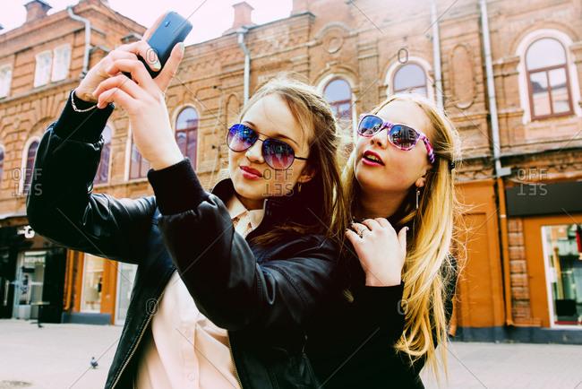 Women taking selfie in city