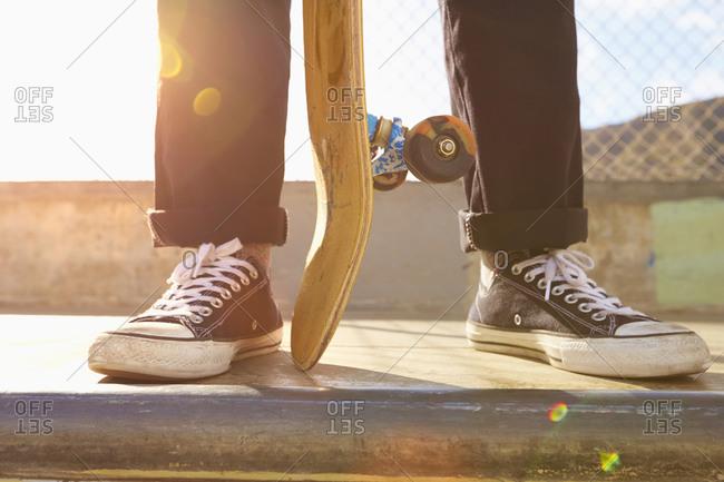 Mixed race men standing on ramp at skate park
