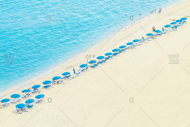 Miami, Florida, USA - April 27, 2015: Aerial view of umbrellas and lawn chairs on beach