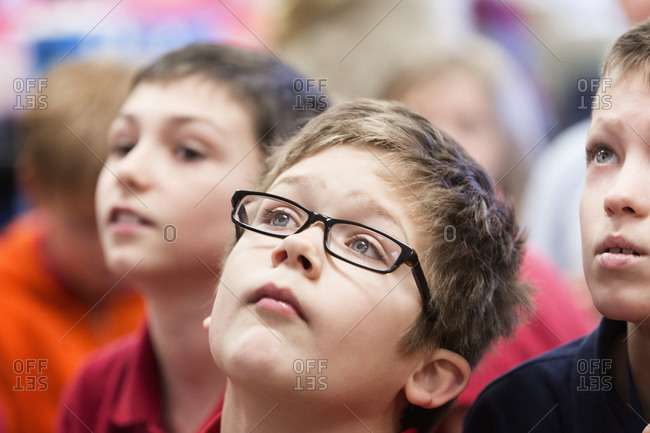 Close up of students listening in classroom
