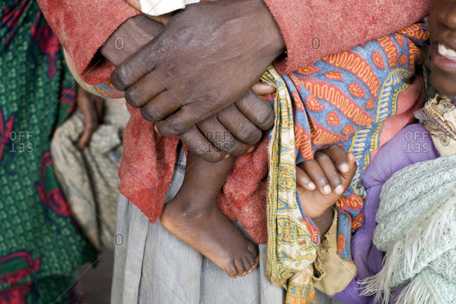 Close up of mother carrying baby with traditional clothing