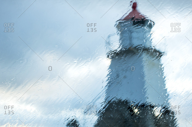 Laukvika Lighthouse viewed through rainy window, Laukvika, Lofoten Islands, Norway