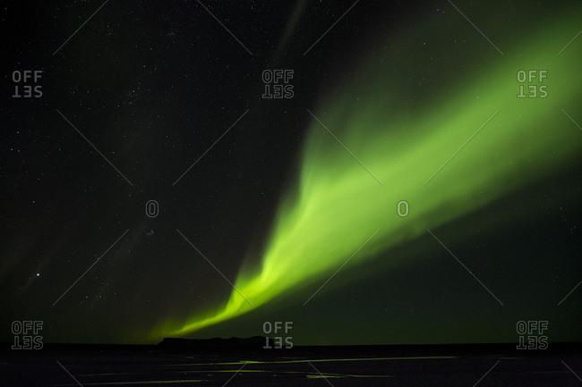 Northern Lights glowing green in night sky