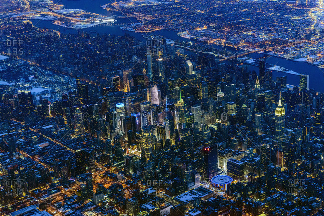 Aerial view of Manhattan cityscape and river at night, New York, United States