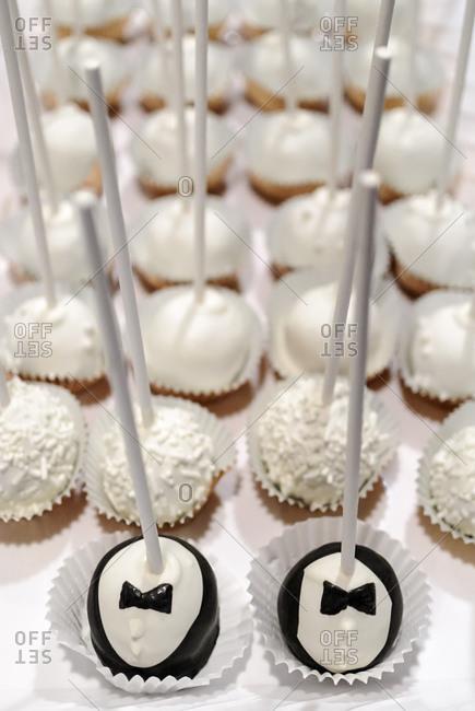Close up of groom cake pops at same sex wedding
