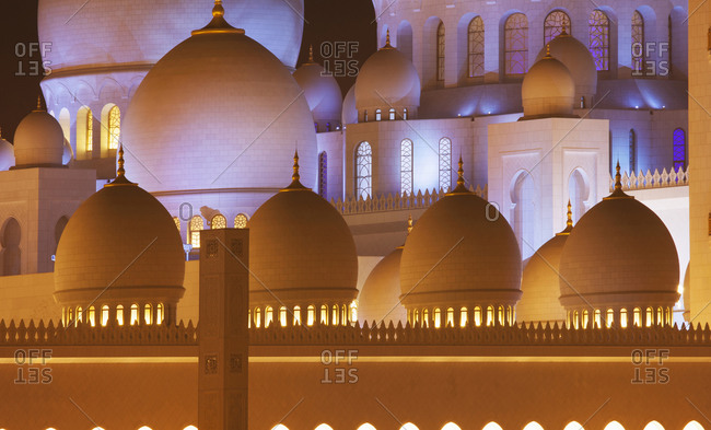 Domes and colonnade of ornate building, Abu Dhabi, Abu Dhabi Emirate, United Arab Emirates