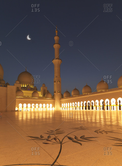Illuminated colonnade, domes and tower at night