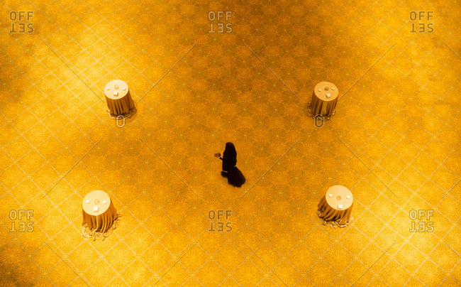 High angle view of woman walking on gold floor