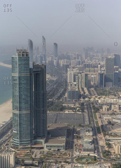 Aerial view of high rise buildings in Abu Dhabi cityscape, Abu Dhabi Emirate, United Arab Emirates