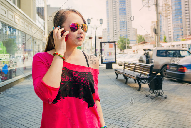 Caucasian teenage girl talking on cell phone