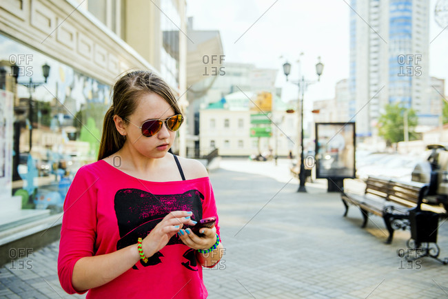 Caucasian teenage girl using cell phone