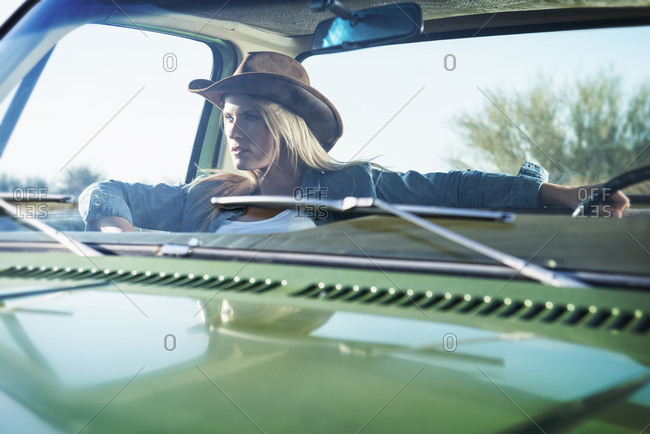 Caucasian woman sitting in truck