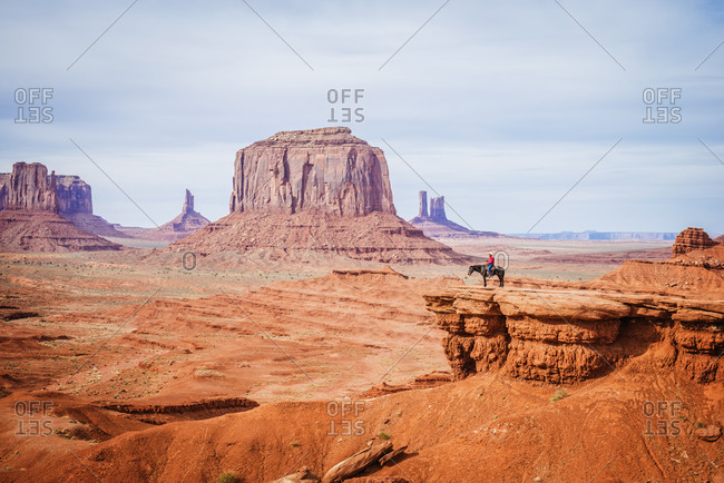 Horseback rider on rock formations in Monument Valley, Utah, United States