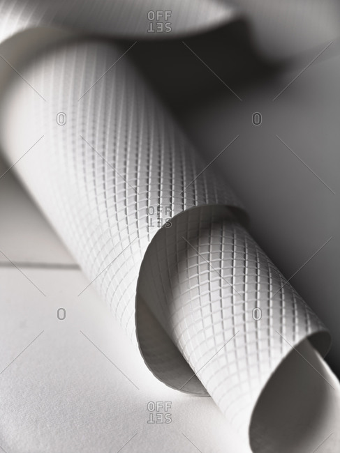 Close up of white rolled plastic sheet