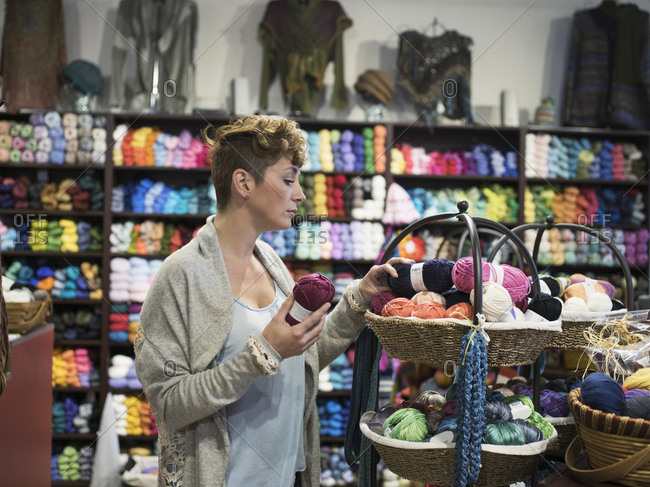 Caucasian woman shopping in yarn store