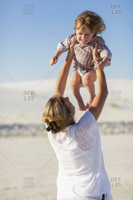 Caucasian mother and son playing in desert