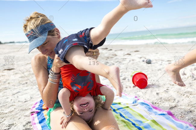 Caucasian family playing on beach