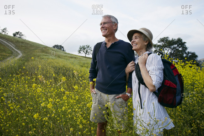 Caucasian couple standing in tall grass