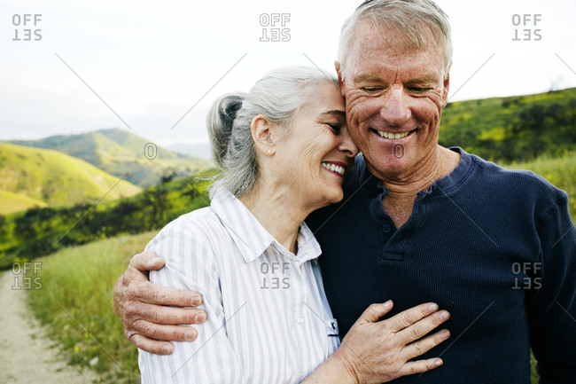 Caucasian couple hugging on hiking trail